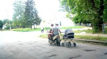 Baby Carriage In Tow