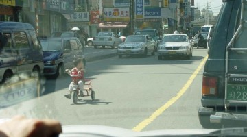Tricycle In Traffic
