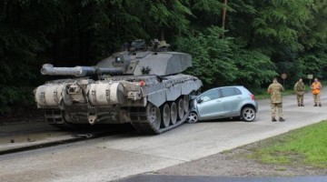 British Tank Completely Demolishes Student Drivers' Little Toyota