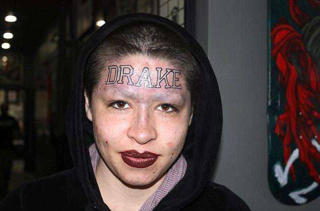 the-girl-with-the-drake-tattoo-photo-u1
